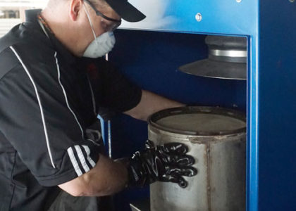 Man cleaning DPF equipment.